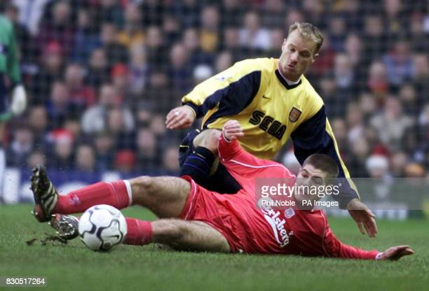 LEAGUE Arsenal's Dennis Bergkamp battles for the ball with Liverpool's Steven Gerrard during the Premiership football match at Anfield Liverpool
