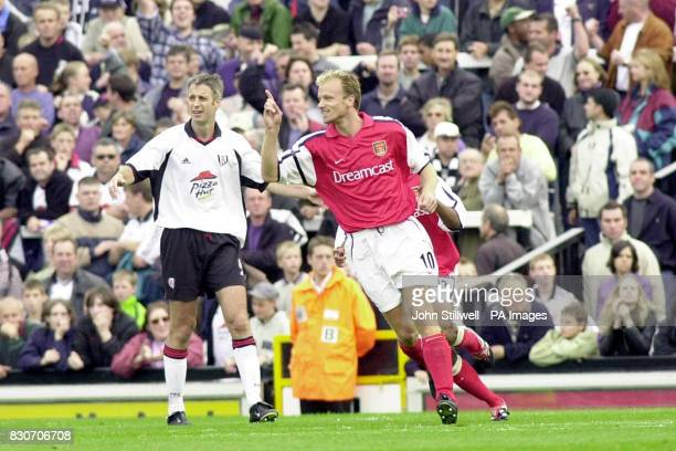 Arsenal's Dennis Bergkamp celebrates after scoring the third goal against Fulham during the Premiership game between Fulham and Arsenal at Craven...
