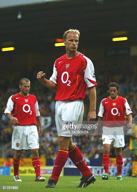 Arsenal's Dennis Bergkamp celebrates his goal against Norwich during their Premiership match 28 August 2004 at Norwich Other players in background...