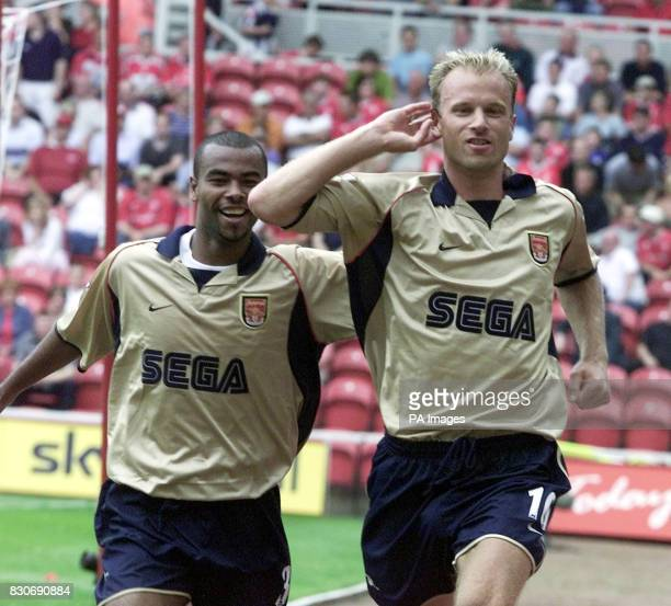 LEAGUE Arsenal's Dennis Bergkamp celebrates his goal with teammate Ashley Cole during the Premiership football match at the Riverside Stadium...