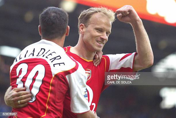 Arsenal's Dennis Bergkamp celebrates scoring his goal against Birmingham during their Premiership match at home to Birmingham 15 May 2005 AFP PHOTO/...