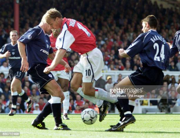 Arsenal's Dennis Bergkamp is caught between Bolton Wanderers' Gudni Bergsson and Anthony Barness right during the FA Barclaycard Premiership game...