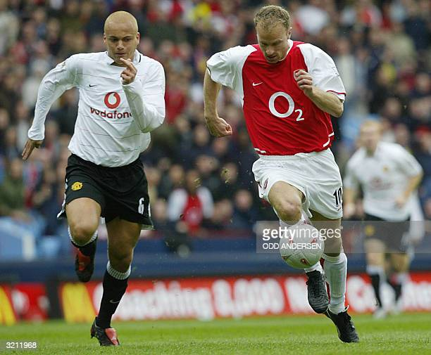Arsenal's Dennis Bergkamp is chased by Wes Brown of Manchester United during their FA Cup semifinal clash at Villa park in Birmingham 03 April 2004...