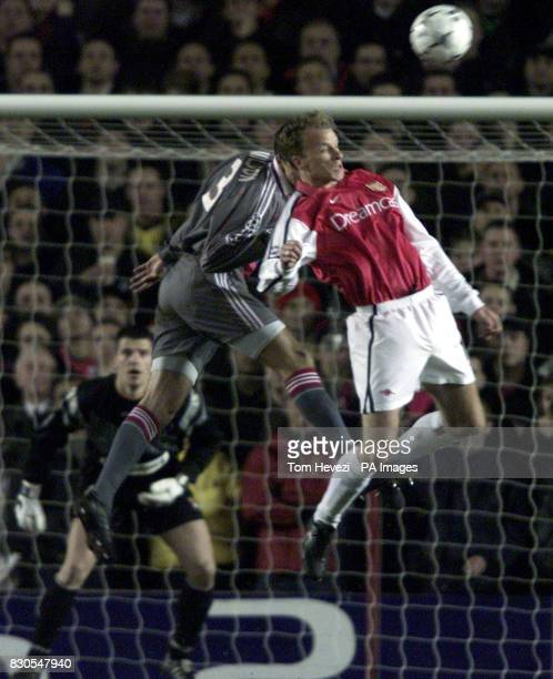 LEAGUE Arsenal's Dennis Bergkamp jumps for the ball with Lyon's Edmilson during the UEFA Champions League football match at Highbury London