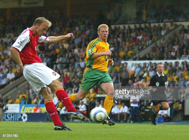 Arsenal's Dennis Bergkamp scores a goal against Norwich during their Premiership match 28 August 2004 at Norwich Other player is unidentified AFP...