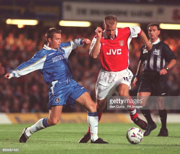 FEATURE Arsenal's Dennis Bergkamp steps round the outstretched leg of Chelsea's Graeme Le Saux during their FA Carling Premiership match at Stamford...