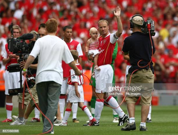 Arsenal's Dennis Bergkamp waves to fans before his Testimonial match against Ajax at Emirates Stadium London