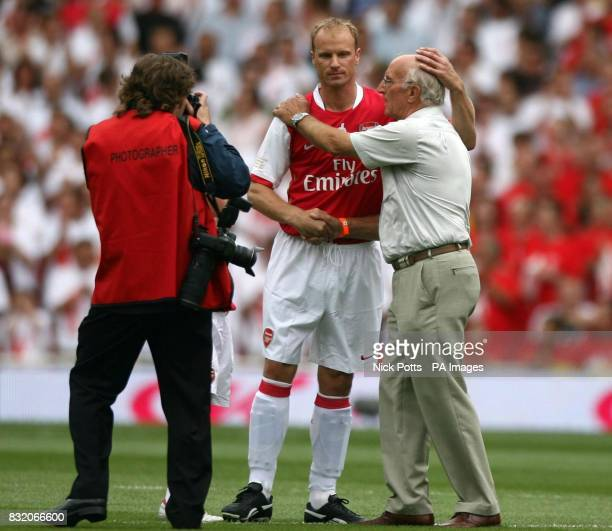 Arsenal's Dennis Bergkamp with his father who took the first kick off togerther before his Testimonial match against Ajax at Emirates Stadium London