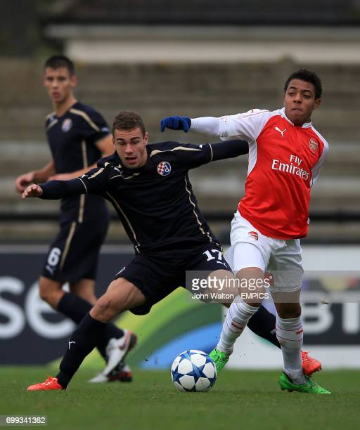 Arsenal's Donyell Malen battles for possession of the ball with Dinamo Zagreb's Marijan Cabraja