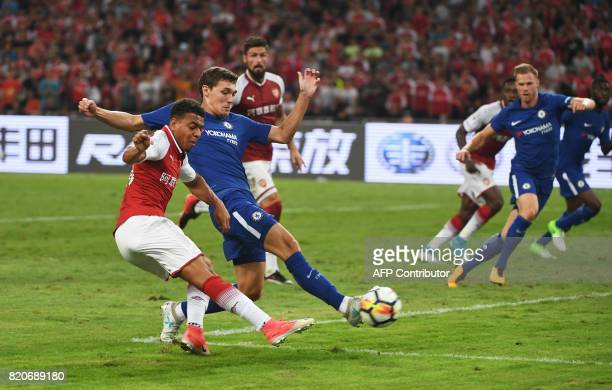 Arsenal's Donyell Malen shoots as Chelsea's Andreas Christensen challenges during their preseason football match in Beijing's National Stadium known...