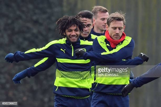 Arsenal's Egyptian midfielder Mohamed Elneny Arsenal's Brazilian defender Gabriel and Arsenal's Spanish defender Nacho Monreal take part in a...