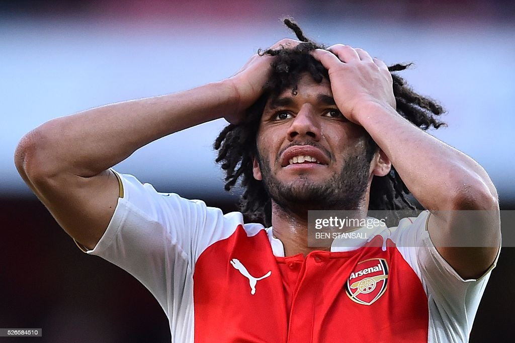 Arsenal's Egyptian midfielder Mohamed Elneny reacts after missing a chance during the English Premier League football match between Arsenal and Norwich at the Emirates Stadium in London on April 30, 2016. / AFP / BEN STANSALL / RESTRICTED TO EDITORIAL USE. No use with unauthorized audio, video, data, fixture lists, club/league logos or 'live' services. Online in-match use limited to 75 images, no video emulation. No use in betting, games or single club/league/player publications. /