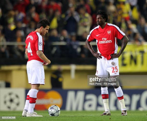 Arsenal's Emmanuel Adebayor and Francesc Fabregas stand dejected after conceding the first goal of the game