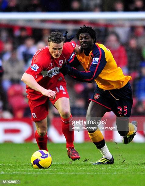 Arsenal's Emmanuel Adebayor and Middlesbrough's Robert Huth battle for the ball