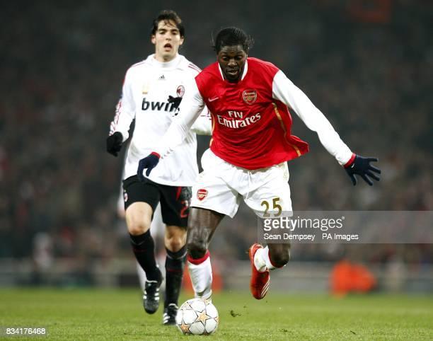 Arsenal's Emmanuel Adebayor breaks clear from AC Milan's Kaka