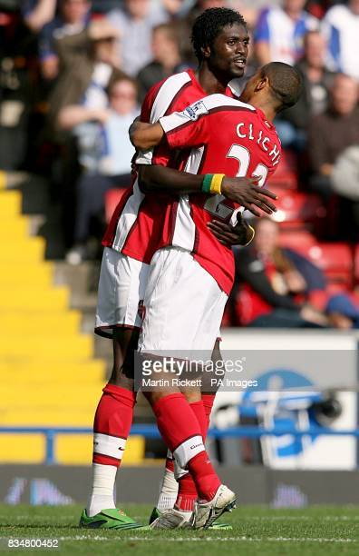 Arsenal's Emmanuel Adebayor celebrates after scoring the second goal with team mate Gael Clichy