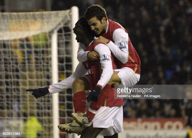 Arsenal's Emmanuel Adebayor celebrates his goal with Francesc Fabregas