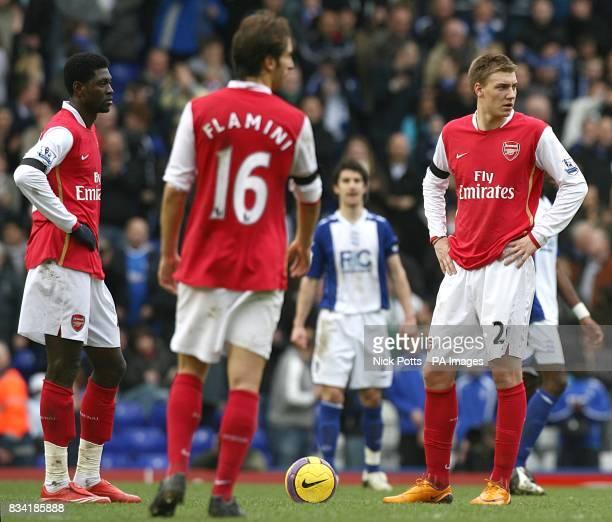 Arsenal's Emmanuel Adebayor Mathieu Flamini and Nicklas Bendtner stand dejected following Birmingham City's James McFadden's penalty equalizer