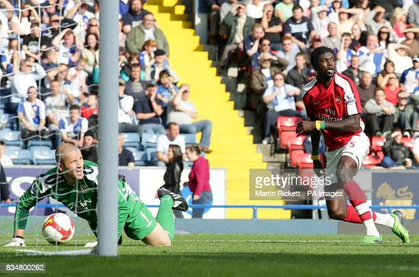 Arsenal's Emmanuel Adebayor turns to celebrate after scoring the second goal as Blackburn Rovers' goalkeeper Paul Robinson looks to the linesman