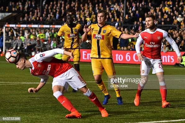 Arsenal's English defender Rob Holding gets his head to the ball during the English FA Cup fifth round football match between Sutton United and...