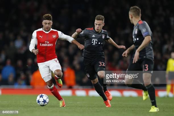 Arsenal's English midfielder Alex OxladeChamberlain vies with Bayern Munich's midfielder Joshua Kimmich during the UEFA Champions League last 16...