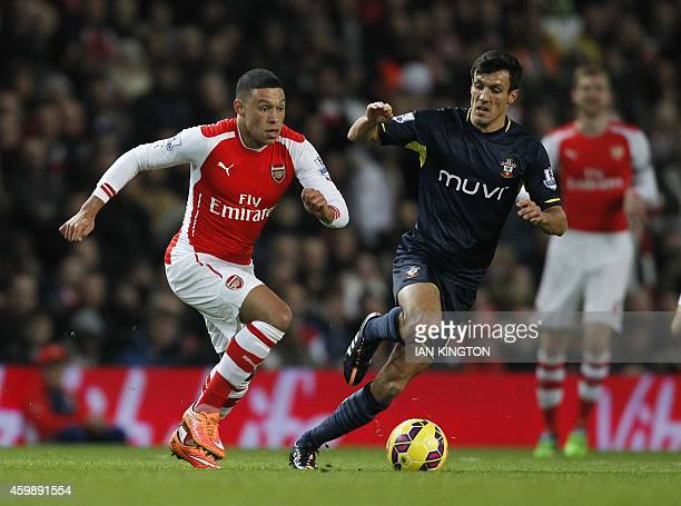 Arsenal's English midfielder Alex OxladeChamberlain vies with Southampton's English midfielder Jack Cork during the English Premier League football...