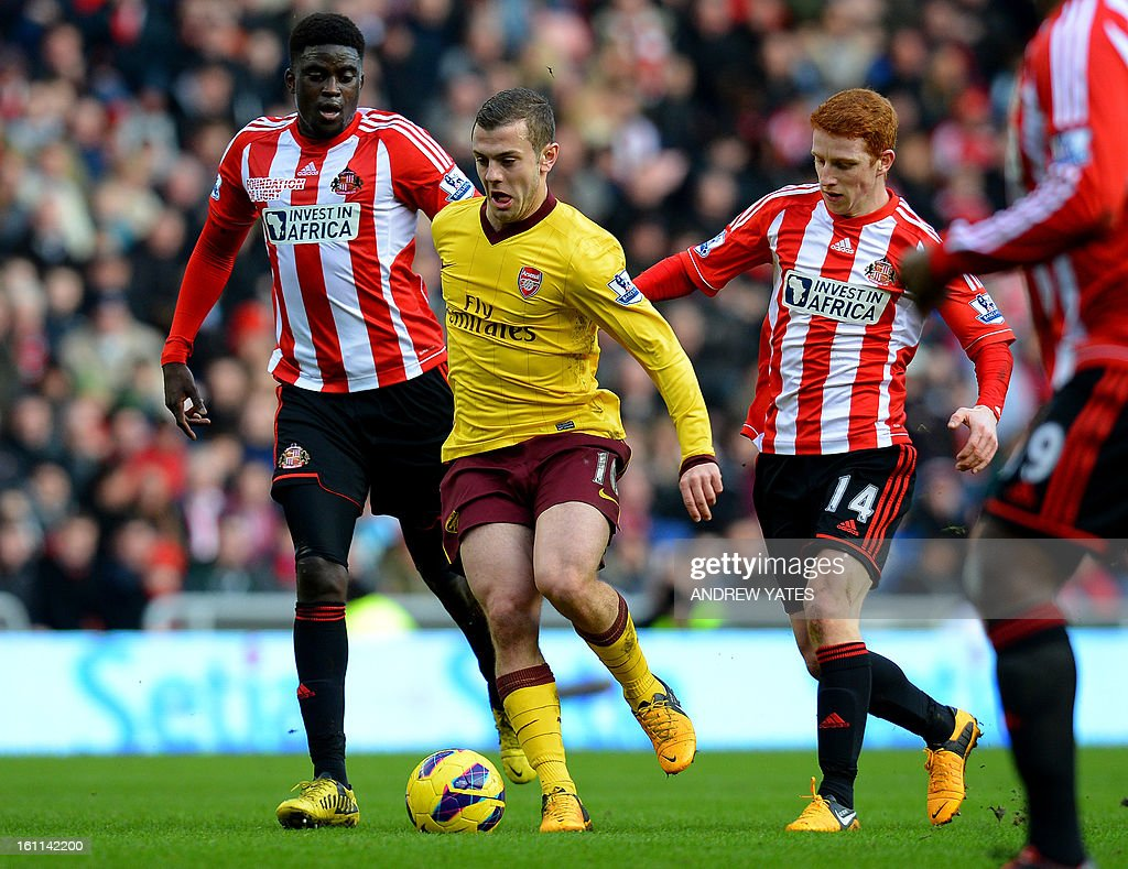 "Arsenal's English midfielder Jack Wilshere (C) vies with Sunderland's French midfielder Alfred N'Diaye (L) and Sunderland's English midfielder Jack Colback during the English Premier League football match between Sunderland and Arsenal at The Stadium Of Light, in Sunderland, northeast England, on February 9, 2013. AFP PHOTO/ANDREW YATES == RESTRICTED TO EDITORIAL USE. No use with unauthorized audio, video, data, fixture lists, club/league logos or ""live"" services. Online in-match use limited to 45 images, no video emulation. No use in betting, games or single club/league/player publications. =="