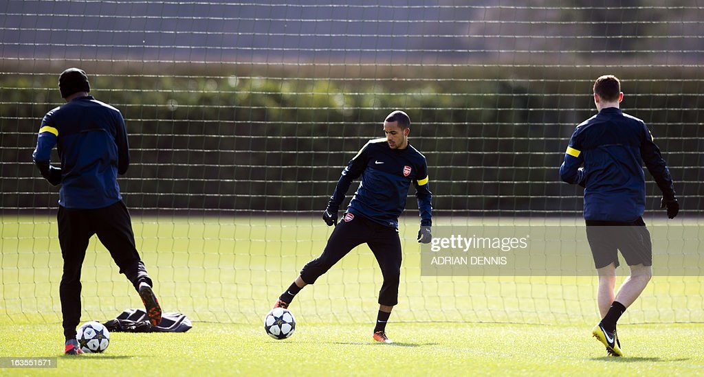 Arsenal's English midfielder Theo Walcott (C) attends a training session at the club's complex in London Colney on March 12, 2013 ahead of the team's last 16 UEFA Champions League football match against Bayern Munich in Germany on March 13.