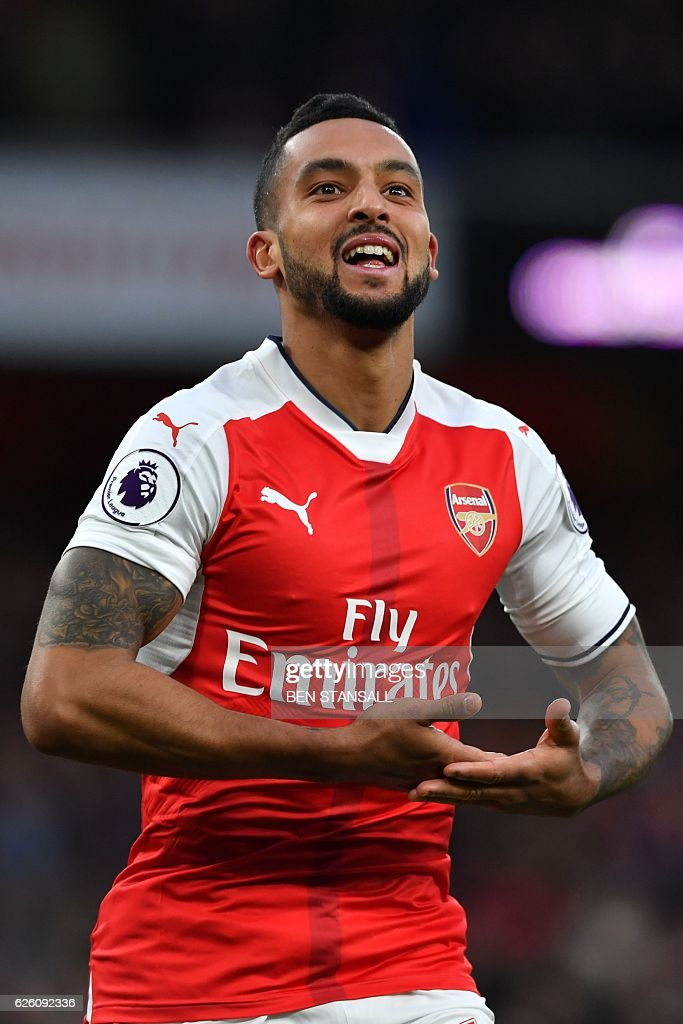 Arsenal's English midfielder Theo Walcott celebrates after scoring their second goal during the English Premier League football match between Arsenal and Bournemouth at the Emirates Stadium in London on November 27, 2016. / AFP / Ben STANSALL / RESTRICTED TO EDITORIAL USE. No use with unauthorized audio, video, data, fixture lists, club/league logos or 'live' services. Online in-match use limited to 75 images, no video emulation. No use in betting, games or single club/league/player publications. /