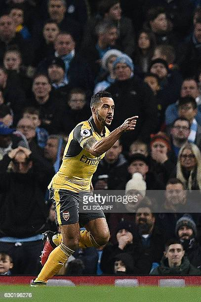 Arsenal's English midfielder Theo Walcott celebrates scoring his team's first goal during the English Premier League football match between...