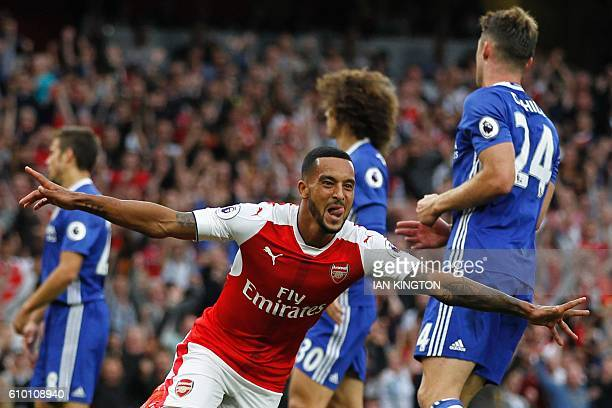 Arsenal's English midfielder Theo Walcott celebrates scoring their second goal during the English Premier League football match between Arsenal and...
