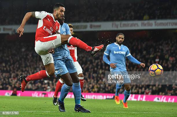 Arsenal's English midfielder Theo Walcott shoots and scores past Stoke City's Portugueseborn Dutch defender Bruno Martins Indi during the English...