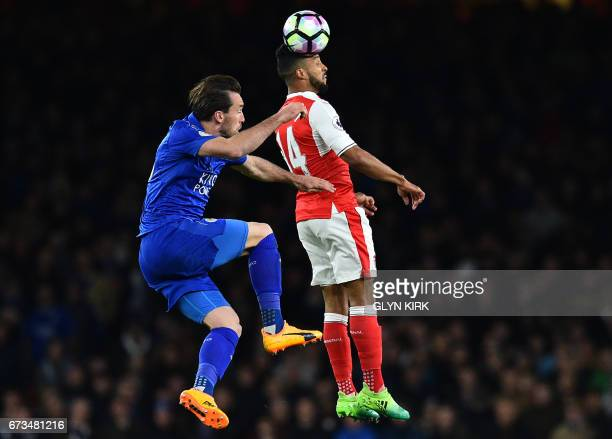 Arsenal's English midfielder Theo Walcott vies with Leicester City's Austrian defender Christian Fuchs during the English Premier League football...