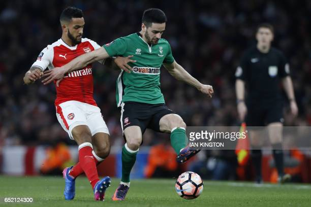 Arsenal's English midfielder Theo Walcott vies with Lincoln City's English defender Sam Habergham during the English FA cup quarter final football...