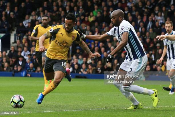 Arsenal's English midfielder Theo Walcott vies with West Bromwich Albion's Frenchborn Cameroonian defender Allan Nyom during the English Premier...