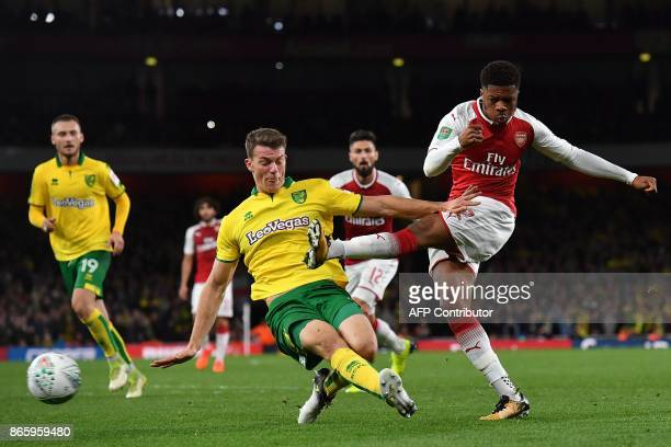 TOPSHOT Arsenal's English striker Chuba Akpom shoots but fails to score during the English League Cup fourth round football match between Arsenal and...