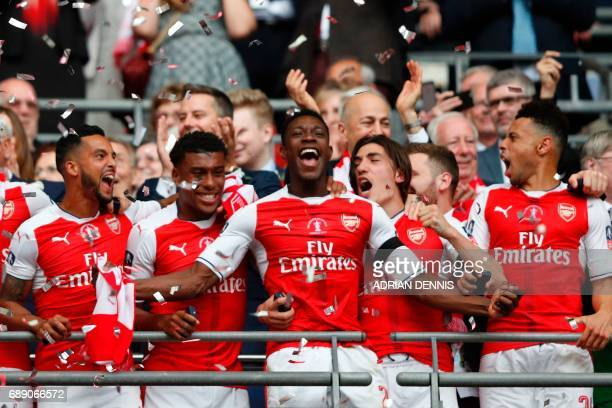 Arsenal's English striker Danny Welbeck and Arsenal players celebrate their victory over Chelsea in the English FA Cup final football match between...