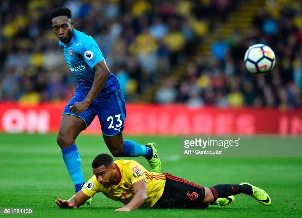 Arsenal's English striker Danny Welbeck battles with Watford's Englishborn Jamaican defender Adrian Mariappa during the English Premier League...