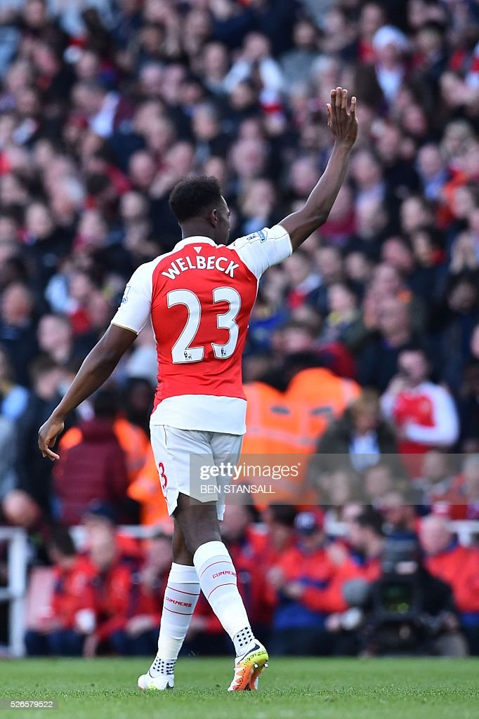 Arsenal's English striker Danny Welbeck celebrates scoring the opening goal during the English Premier League football match between Arsenal and Norwich at the Emirates Stadium in London on April 30, 2016. / AFP / BEN STANSALL / RESTRICTED TO EDITORIAL USE. No use with unauthorized audio, video, data, fixture lists, club/league logos or 'live' services. Online in-match use limited to 75 images, no video emulation. No use in betting, games or single club/league/player publications. /