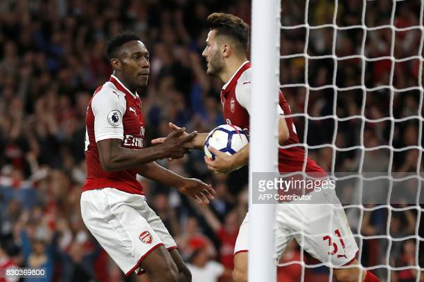 Arsenal's English striker Danny Welbeck celebrates with Arsenal's Germanborn Bosnian defender Sead Kolasinac after scoring their second goal during...