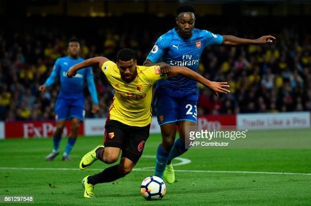 Arsenal's English striker Danny Welbeck pressures Watford's Englishborn Jamaican defender Adrian Mariappa during the English Premier League football...