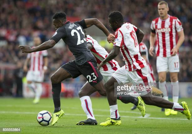 Arsenal's English striker Danny Welbeck runs through the Stoke defence during the English Premier League football match between Stoke City and...