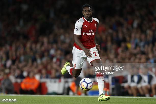 Arsenal's English striker Danny Welbeck runs with the ball during the English Premier League football match between Arsenal and Leicester City at the...