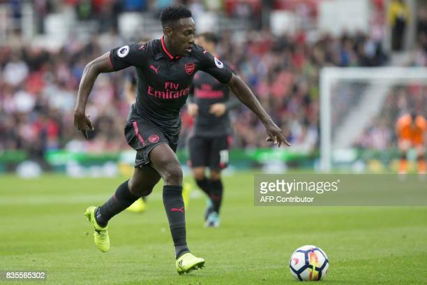 Arsenal's English striker Danny Welbeck runs with the ball during the English Premier League football match between Stoke City and Arsenal at the...