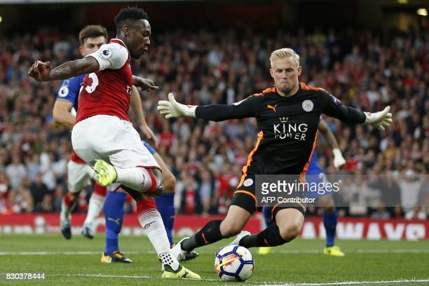 Arsenal's English striker Danny Welbeck vies with Leicester City's Danish goalkeeper Kasper Schmeichel during the English Premier League football...