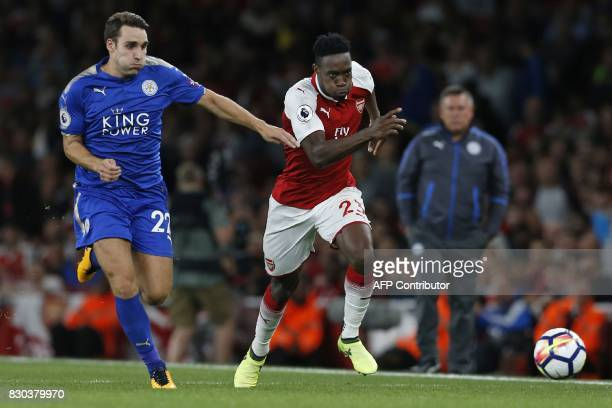 Arsenal's English striker Danny Welbeck vies with Leicester City's English midfielder Matty James during the English Premier League football match...