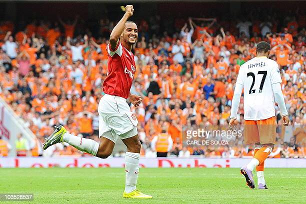 Arsenal's English striker Theo Walcott celebrates after scoring a third goal during the English Premier League football match between Arsenal and...