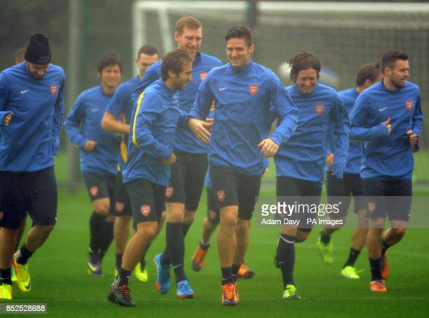 Arsenal's Flamini and Olivier Giroud during a training session at London Colney St Albans