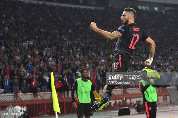 TOPSHOT Arsenal's forward Olivier Giroud celebrates after scoring a goal during the UEFA Europa League football between Belgrade and Arsenal on...