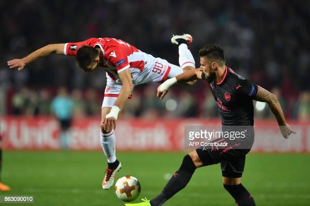 Arsenal's forward Olivier Giroud vies with Belgrade's defender Vujadin Savic during the UEFA Europa League football between Belgrade and Arsenal on...